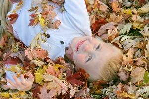 boy in leaves dreamstime_m_46019777